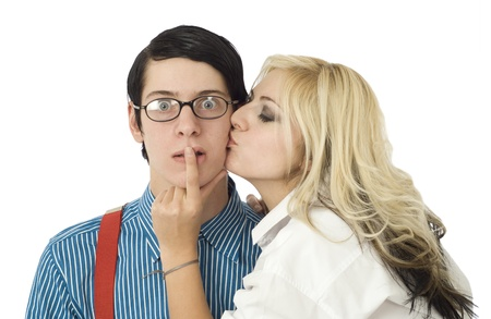 Nerd business man surprised by kiss from pretty valentine girl isolated on white photo