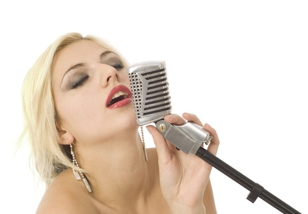 Pretty woman or girl music singer with microphone on white Stock Photo - 10706545