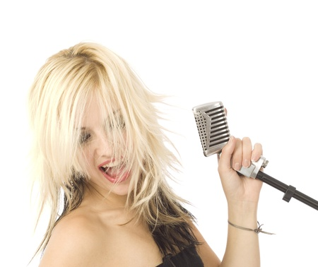 Rocking singer with wild hair and microphone Stock Photo