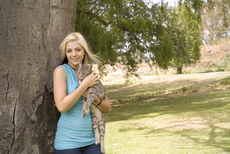 Woman or girl with pet cat in garden Stock Photo - 10768251