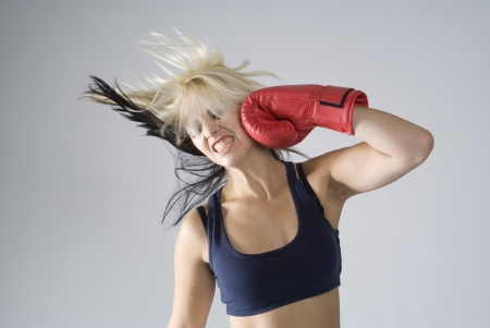 girl punch: Concept of woman punching herself as self punishment Stock Photo