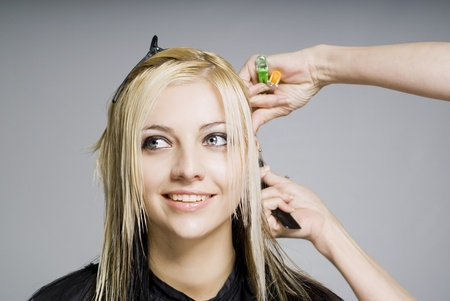 happy client: Smiling happy client while hairdresser cutting hair Stock Photo