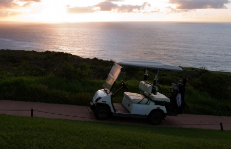 Golf cart at beach or seaside holiday resort course photo