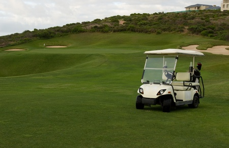 Golf cart at beach or seaside holiday resort course