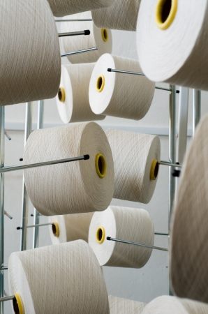 Rolls of industrial cotton fabric for clothing cloth textile manufacture on machine photo