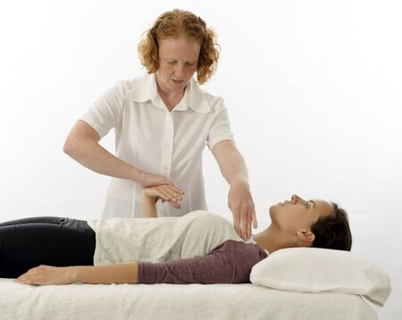 Kinesiology practitioner or kinesiologist test indicator muscle Banco de Imagens