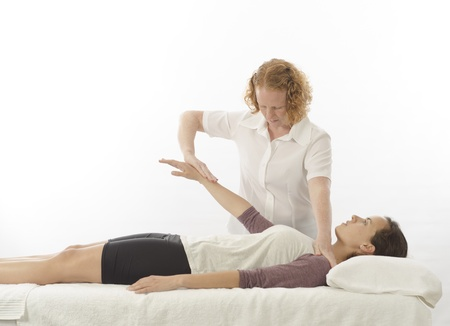 anterior: Kinesiologist or physiotherapist treating anterior deltoid Stock Photo