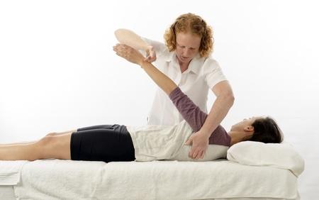 Kinesiologist or physiotherapist treating anterior serratus photo
