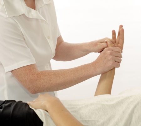physio: Kinesiologist or physiotherapist treating hand opponens pollicis
