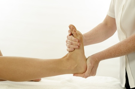 physio: Kinesiologist or physiotherapist treating foot tibialis