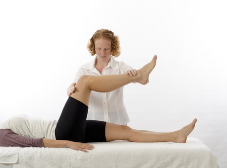 quadriceps: Kinesiologist or physiotherapist treating quadriceps