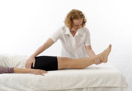 Kinesiologist or physiotherapist treating Adductors