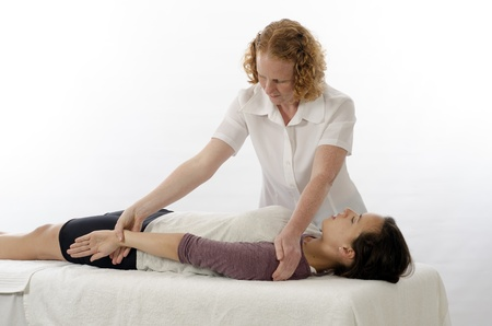 dorsi: Kinesiologist or physiotherapist treating Latissimus Dorsi Stock Photo