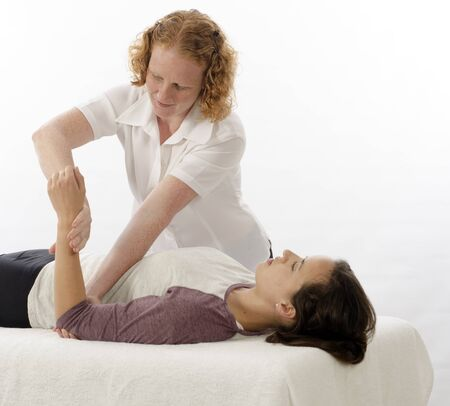 pain relief: Kinesiologist or physiotherapist treating Brachioradialis Stock Photo