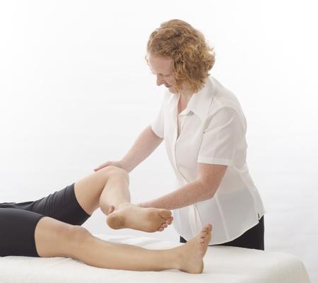 Kinesiologist or physiotherapist treating Sartorius photo
