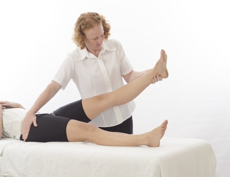 Kinesiologist or physiotherapist treating leg photo