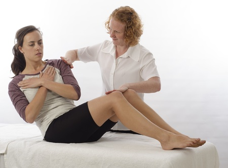 Kinesiologist or physiotherapist treating Abdominals