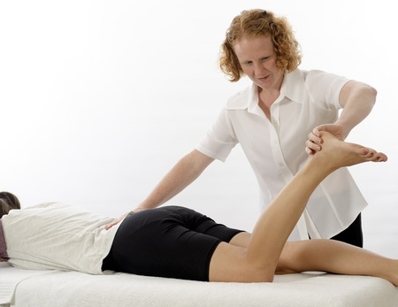 Kinesiologist or physiotherapist treating foot photo