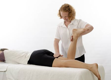 treating: Kinesiologist or physiotherapist treating Hamstrings Stock Photo