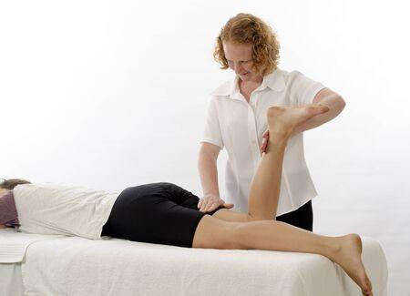 physical test: Kinesiologo o fisioterapista trattamento Muscoli posteriori della coscia Archivio Fotografico