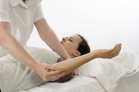 physio: Kinesiologist or physiotherapist treating Rhomboids Stock Photo