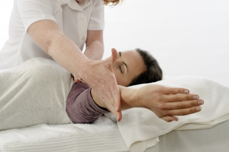Kinesiologist or physiotherapist treating Trapezius photo