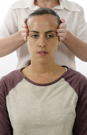stress test: Kinesiologist or physiotherapist treating Neuro vascular holding - emotional stress release Stock Photo