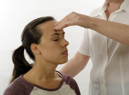 physical exam: Kinesiologist or physiotherapist treating Neuro vascular holding - emotional stress release Stock Photo