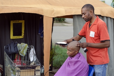 barber shops: Energy efficient African small business barber with inverter and car batteries in trolley