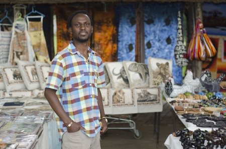 African small business curio salesman selling ethnic items in Howick, KwaZulu-Natal South Africa photo