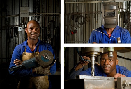 skilled labour: South African or American black workers or welders in factory Stock Photo