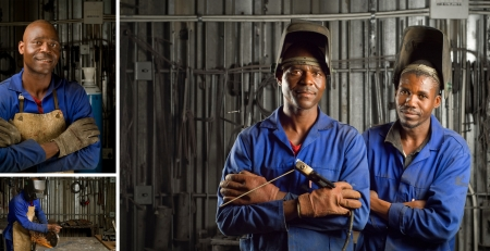 South African or American black workers or welders in factory Standard-Bild