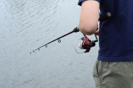 Boy fishing in bass dam or lake Stock Photo - 17161175