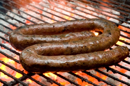 Tradtional South African braai barbecue borewors sausage on fire photo