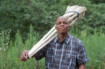 Black South African entrepreneur small business broom salesman in Hilton, Pietermaritzburg, Kwazulu-Natal Stock Photo - 17536864