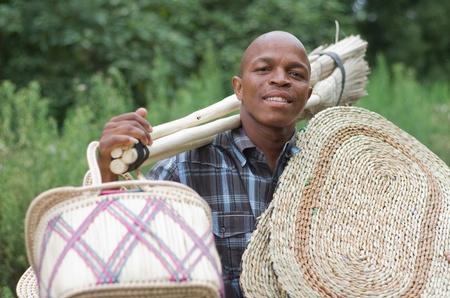 Stock photograph of a black South African entrepreneur small  business broom salesman in Hilton, Pietermaritzburg, Kwazulu-Natal photo
