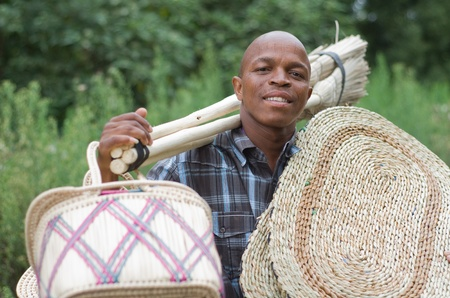 Stock photograph of a black South African entrepreneur small  business broom salesman in Hilton, Pietermaritzburg, Kwazulu-Natal Stock Photo