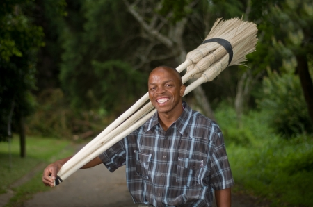 Stock photograph of a smiling black South African entrepreneur small business broom salesman in Hilton, Pietermaritzburg, Kwazulu-Natal Stock Photo - 17536860