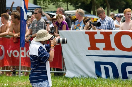 howick: MIDMAR DAM - 10 FEBRUARY 2013: An unidentified news photographer captures images at the 2013 Midmar Mile event near Howick, KwaZulu-Natal, South Africa