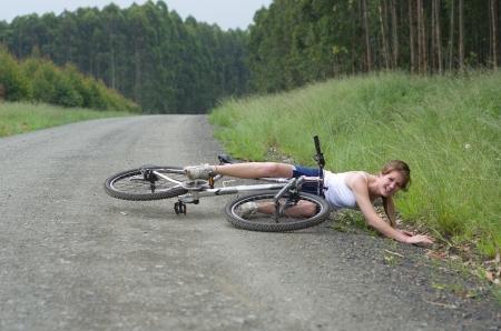 sports injury: Girl hurt crashing bicyble accident Stock Photo