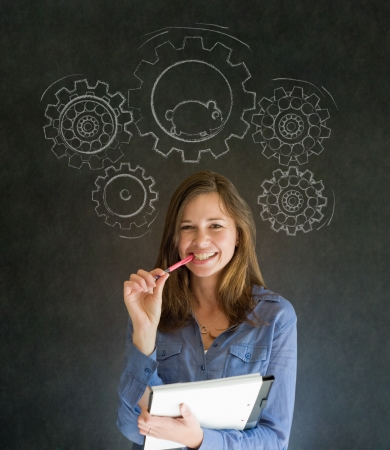 Thinking business woman turning gear cogs and running hamster Stock Photo - 18412717