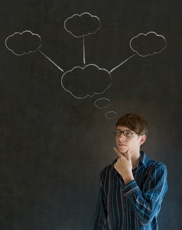 Thinking business man with chalk cloud thoughts on blackboard background Stock Photo - 18463462
