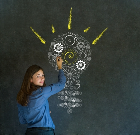 solve: Bright idea gear cog lightbulb thinking business woman Stock Photo