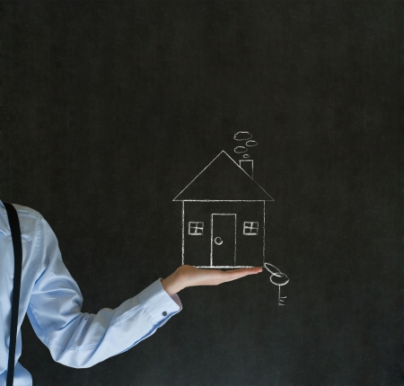 Man teacher, salesman, student or businessman holding chalk house, home or real estate with key