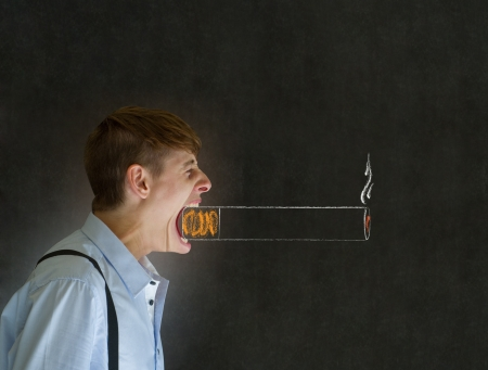 Angry big mouth businessman, teacher or student man smoking chalk cigarette on blackboard background photo
