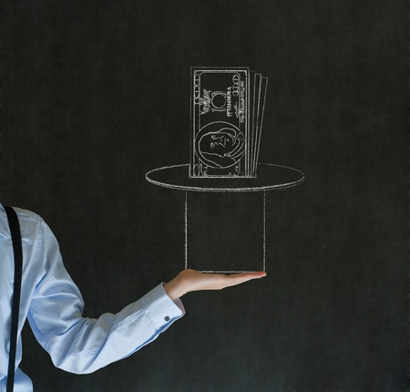Business man, student or teacher pulling money from a magic hat on blackboard background photo