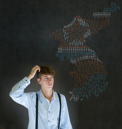 Business man, student, teacher or politician with missile war map on blackboard background thinking about problems in North and South Korea photo