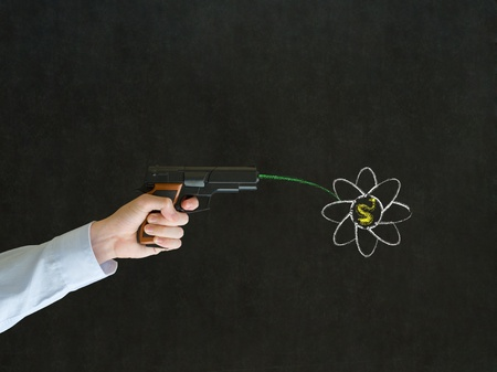 Business man, student or teacher pointing a gun with peace hippie flower on blackboard background photo
