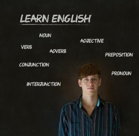 Learn English confident handsome man teacher chalk blackboard background photo