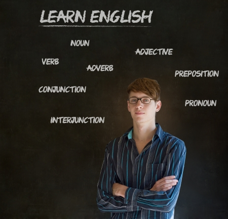 Learn English confident handsome man teacher chalk blackboard background photo